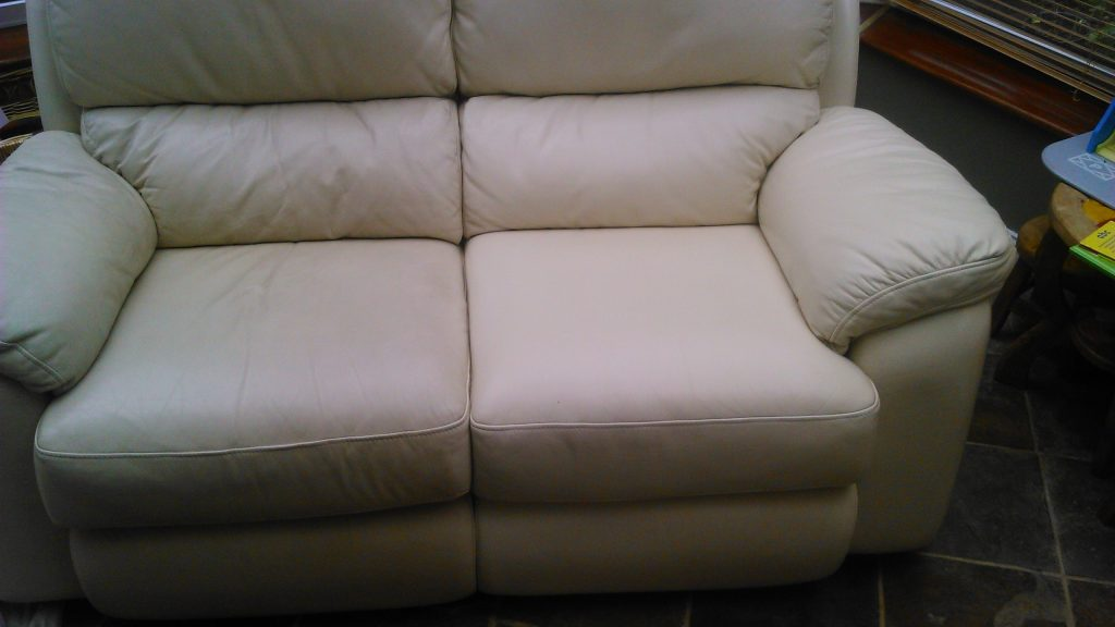 picture of a leather couch being cleaned
