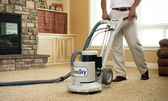 Carpet cleaning technician cleaning carpet